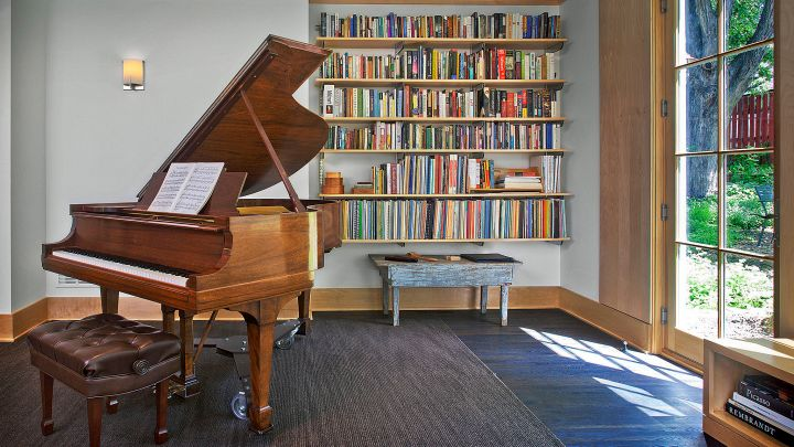 home music room with CD library and piano