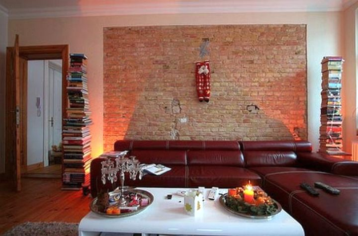 maroon living room with brick panel