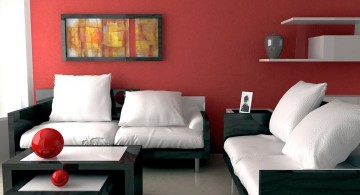 maroon living room with monochrome sofa set