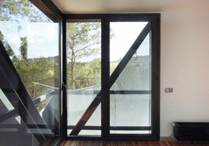 modern glass door with dark wood
