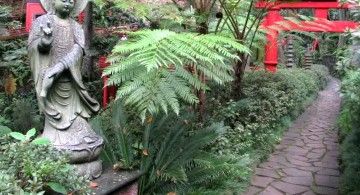 oriental garden design with statue and red gate