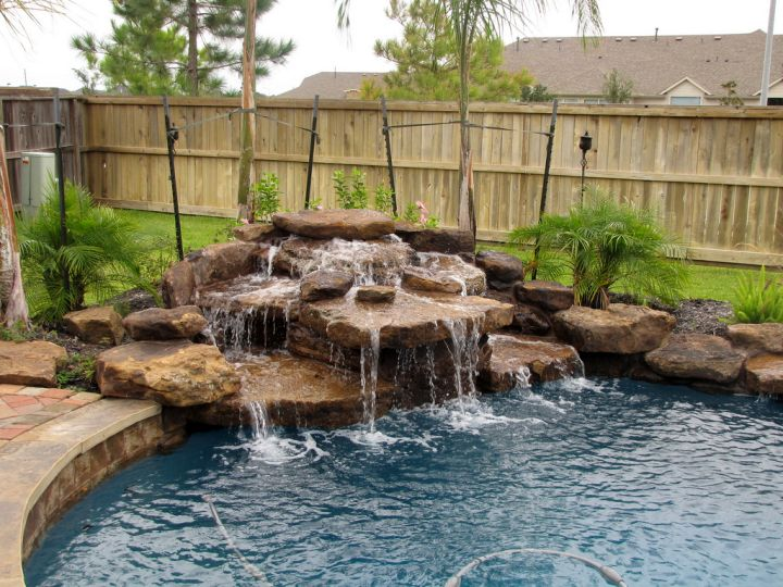 Pool waterfall ideas in the corner for Above ground pool waterfall ideas