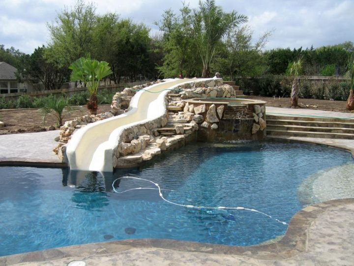 Pool waterfall ideas with curved slide for Above ground pool waterfall ideas