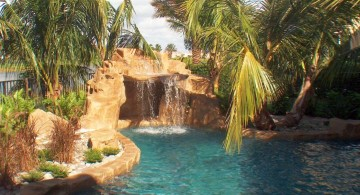 pool waterfall ideas with tall trees