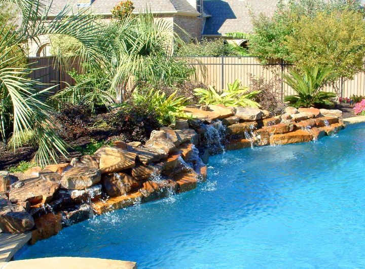 17 lively pool waterfall ideas that will blow you away for Pool design waterfall