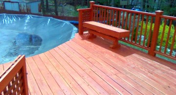 simple wood pool deck with sitting area