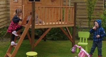 small prefab treehouse on stilts