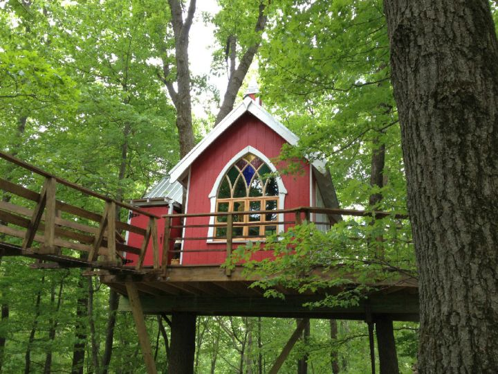 treehouse on stilts in red