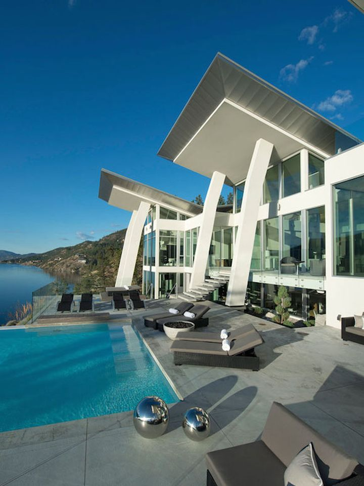 ultramodern lake house pool side facade