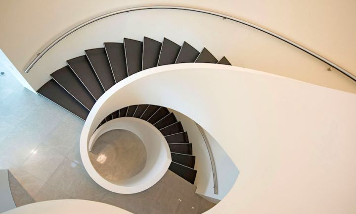 ultramodern lake house spiral stairs