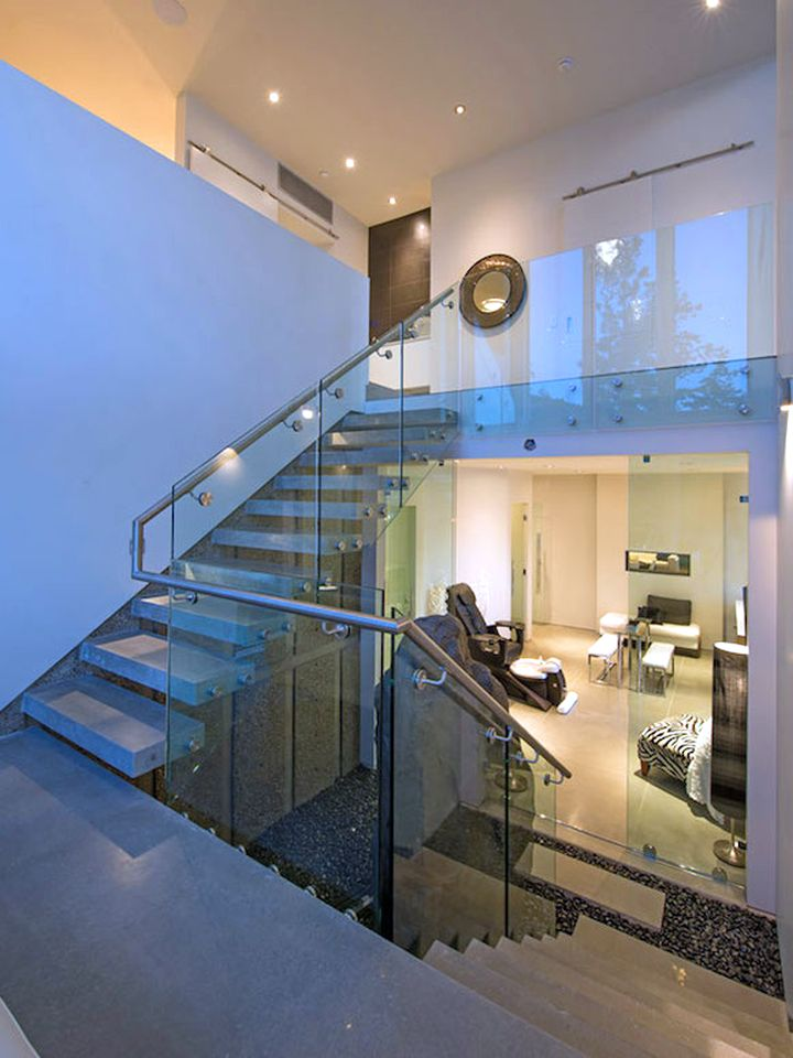 ultramodern lake house stairs to the basement