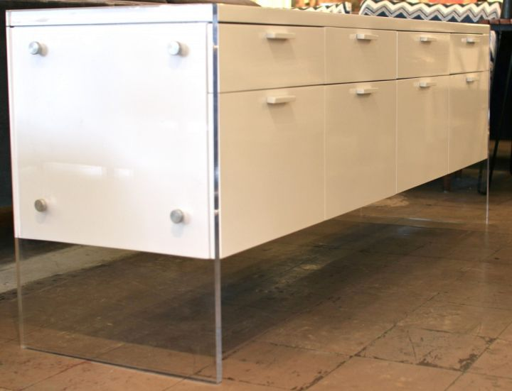 white lacquer credenza with acrylic stands