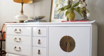 white lacquer credenza with chinese coin accent