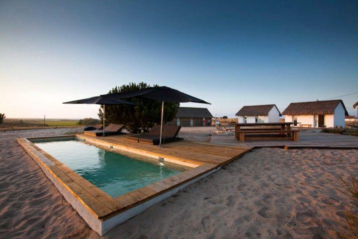 wood pool deck in sandy area