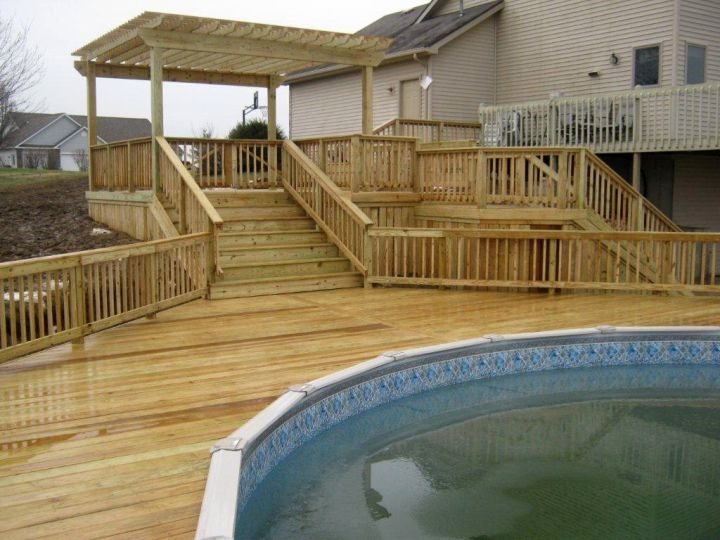 18 contemporary swimming pool wooden deck designs for Above ground pool decks attached to house