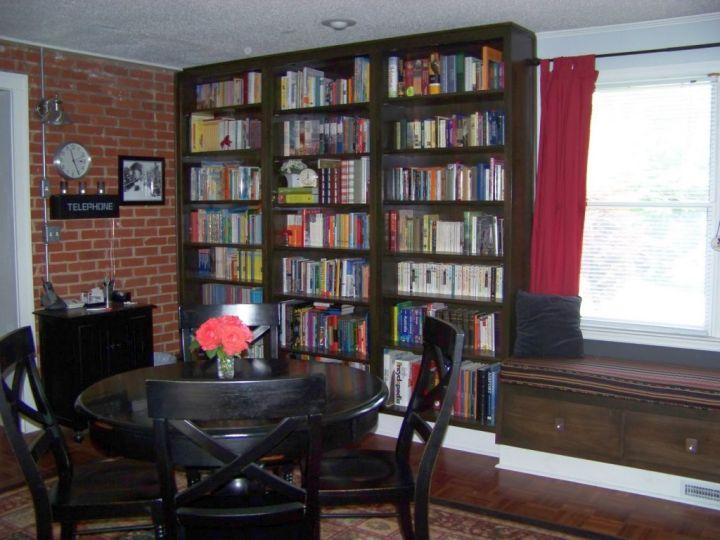 DIY bookshelves in dining room with dark wood furnitures