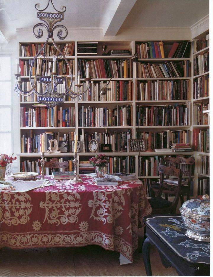 bohemian chandelier with bookshelves in dining room
