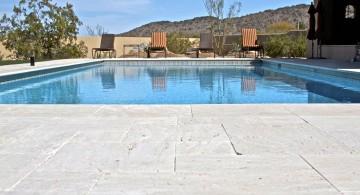 brick paved pool deck stone