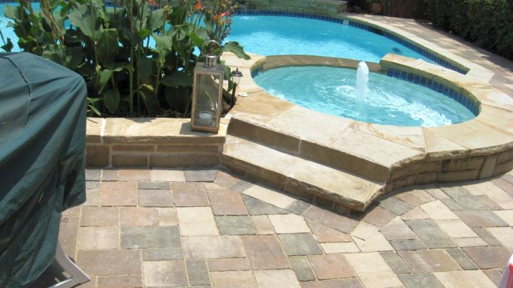 bright colored brick paved pool deck stone