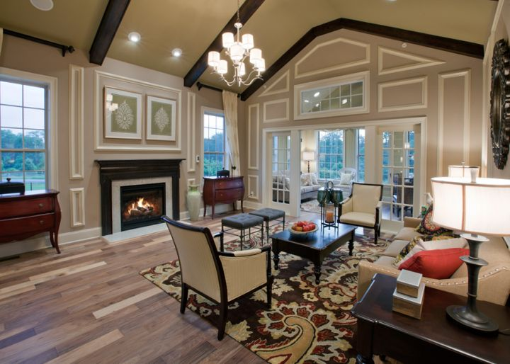 cathedral ceiling living room in black and white with fireplace and chandelier