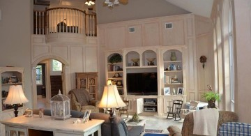 cathedral ceiling living room with indoor balcony