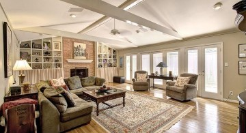 cathedral ceiling living room with wooden floor and crossed beams