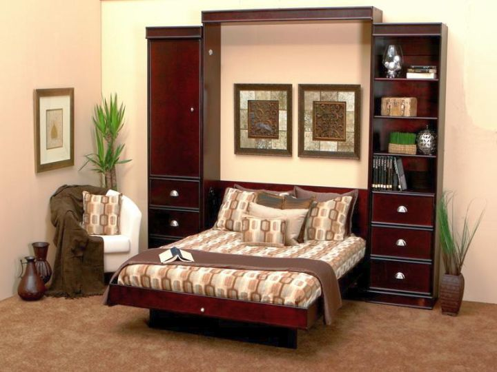 Murphy bed couch can also be used in the home library  in the garage