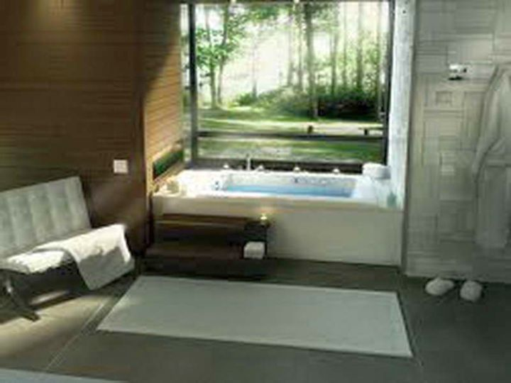 contemporary Japanese bathroom designs with tub outlooking the garden