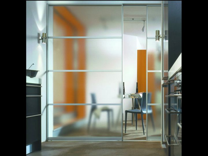 frosted modern sliding glass door designs as separator to the dining