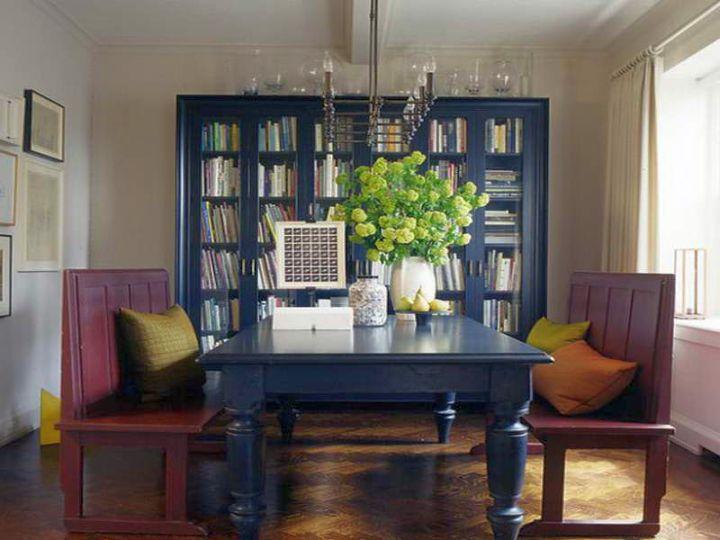 minimalistic blue bookshelves in dining room