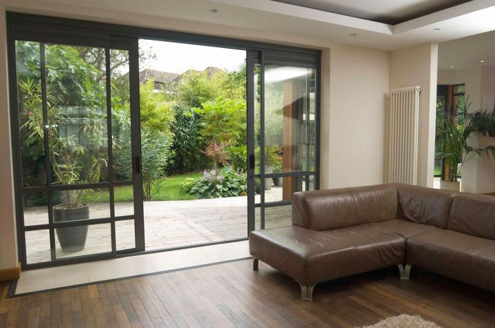 Modern Sliding Glass Door Designs For Living Room With Wooden Floor And Brown