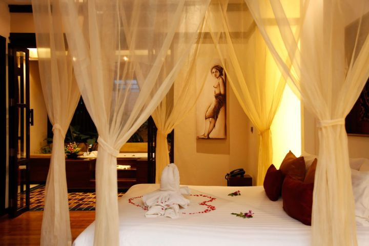 most romantic bedrooms with canopied bed and flower petals