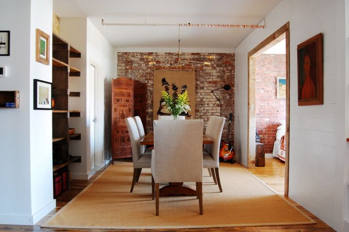 mounted bookshelves in dining room for small space