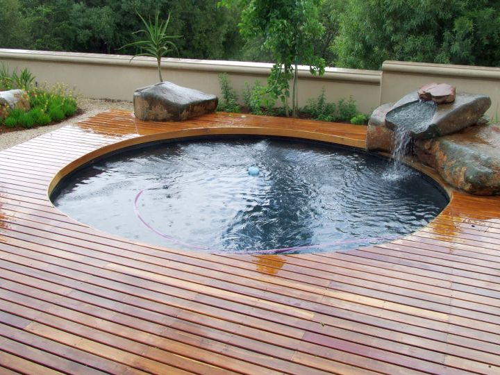 round swimming pools for small spaces with wooden deck