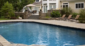 simple grey paved pool deck stone