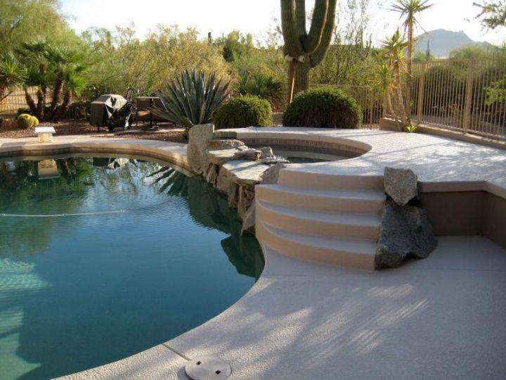 simple paved pool deck stone
