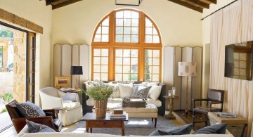 tuscan living room designs with cathedral ceiling and unique chandelier