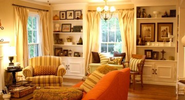 warm tuscan living room colors with bright orange sofa