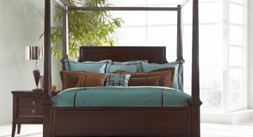 Exotic modern canopy bed design made of dark wood