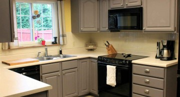 Grey painted kitchen cabinets in small kitchen space