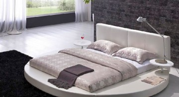 Modern Round Bed Design with White Leather in Black and White Bedroom Interior