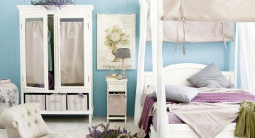 White Wooden Four Poster Canopy Bed With Blue Wall Paint in Modern Bedroom