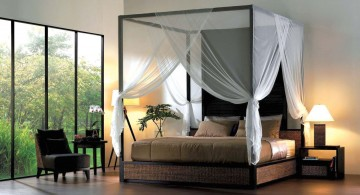 Zen-like master bedroom featuring dark-finished canopy bed sets