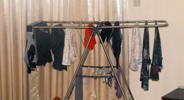 wide laundry room clothes hanger racks designs