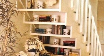 Bookshelf stuffed and decorated under the staircase