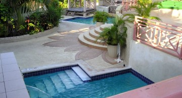 L shaped small pool with tiki hut