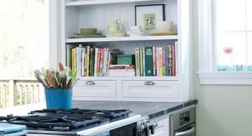 Shelf for recipe books in a white modern kitchen