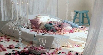 bedroom decoration for valentines day with flower petals and many cushions