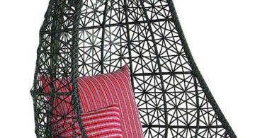 bedroom swing chair in black wicker with magenta cushion