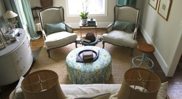 blue and brown living room with Victorian chairs